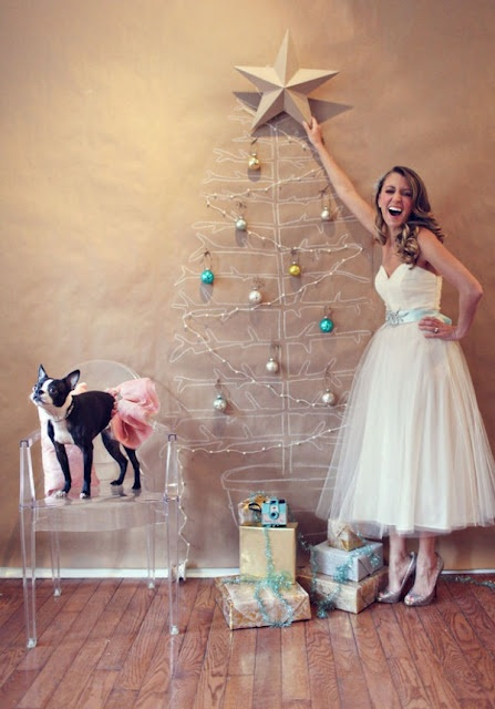 bride-putting-star-on-christmas-tree